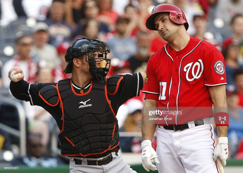Ryan Zimmerman #11 (R) of the Washington Nationals grimaces as he is called out on strikes against the Miami Marlins in the bottom of the ninth inning of game 1 of their day-night doubleheader at Nationals Park on September 22, 2013 in Washington, DC. Also pictured is catcher Jeff Mathis #6 of the Miami Marlins (L). The Marlins won the game, 4-2.