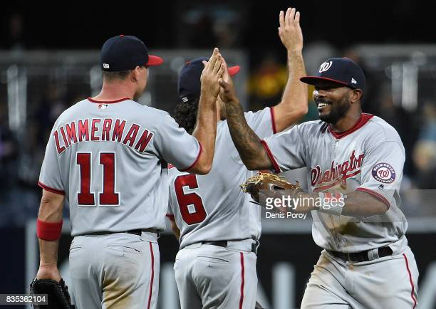 Ryan Zimmerman of the Washington Nationals high fives Howie Kendrick after beating the San Diego Padres 71 in a baseball game at PETCO Park on August...