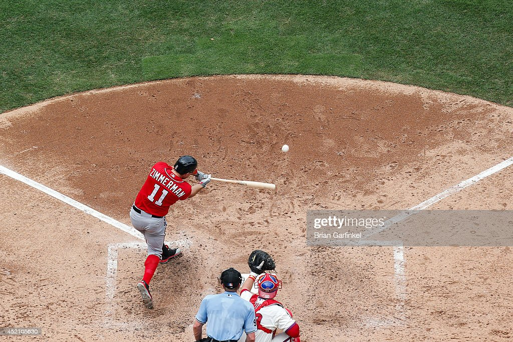 <a gi-track='captionPersonalityLinkClicked' href=/galleries/search?phrase=Ryan+Zimmerman+-+Baseball+Player&family=editorial&specificpeople=534809 ng-click='$event.stopPropagation()'>Ryan Zimmerman</a> #11 of the Washington Nationals hits a sacrifice fly in the sixth inning of the game against the Philadelphia Phillies at Citizens Bank Park on July 13, 2014 in Philadelphia, Pennsylvania.