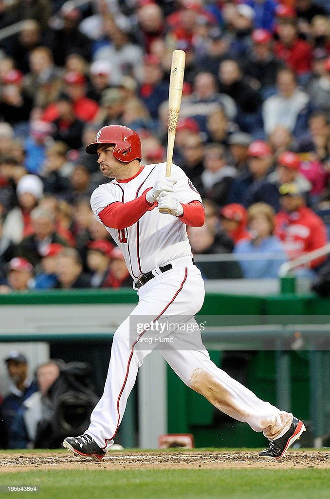 Ryan Zimmerman #11 of the Washington Nationals hits a single in the seventh inning against the Miami Marlins at Nationals Park on April 4, 2013 in Washington, DC.