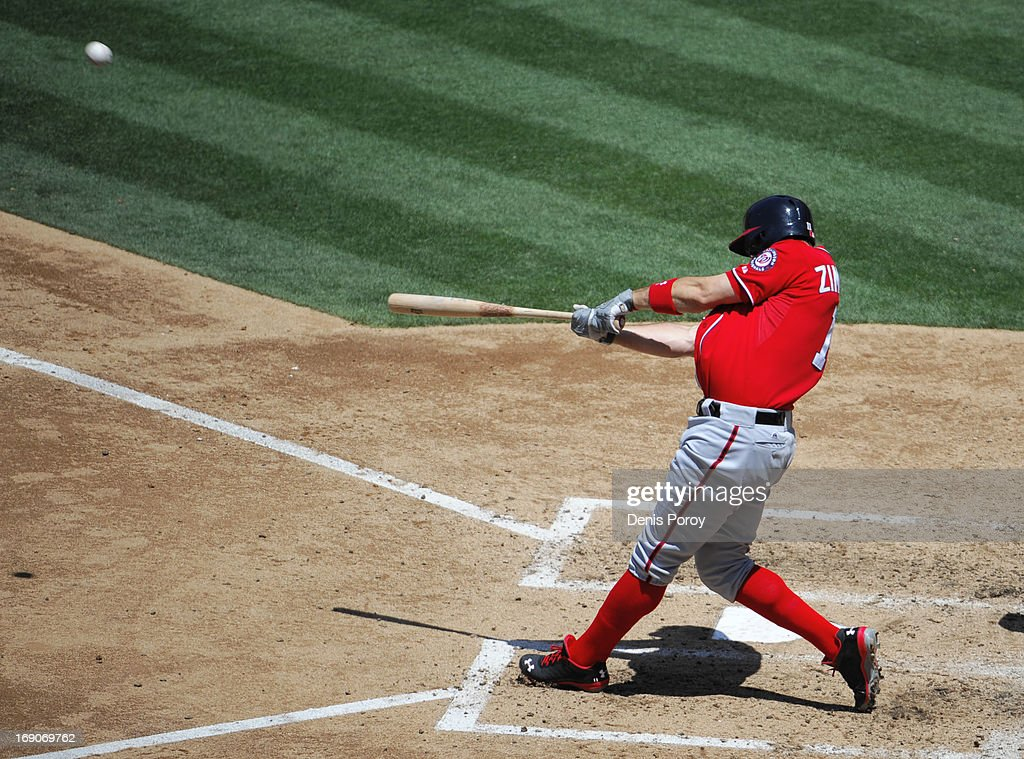 Ryan Zimmerman #11 of the Washington Nationals hits a two-run homer during the fourth inning of a baseball game against the San Diego Padres at Petco Park on May 19, 2013 in San Diego, California.