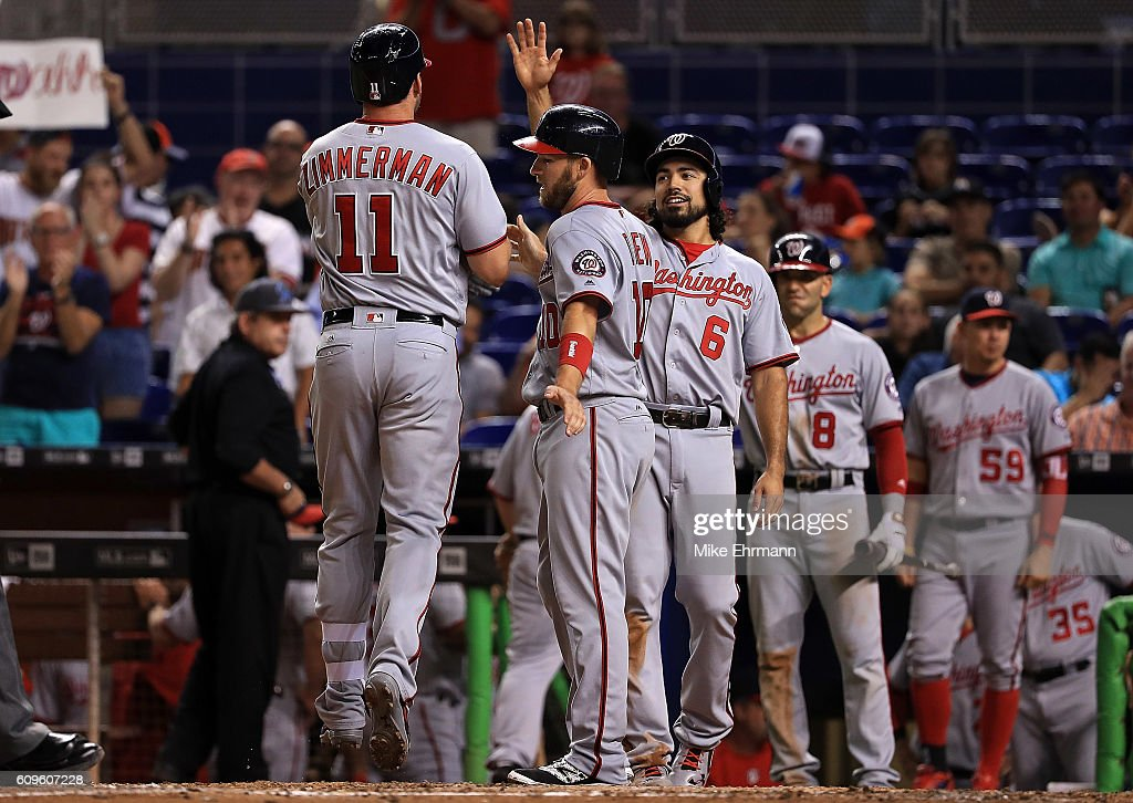 Ryan Zimmerman #11 of the Washington Nationals is congratulated after hitting a three run home run during a game against the Miami Marlins at Marlins Park on September 21, 2016 in Miami, Florida.