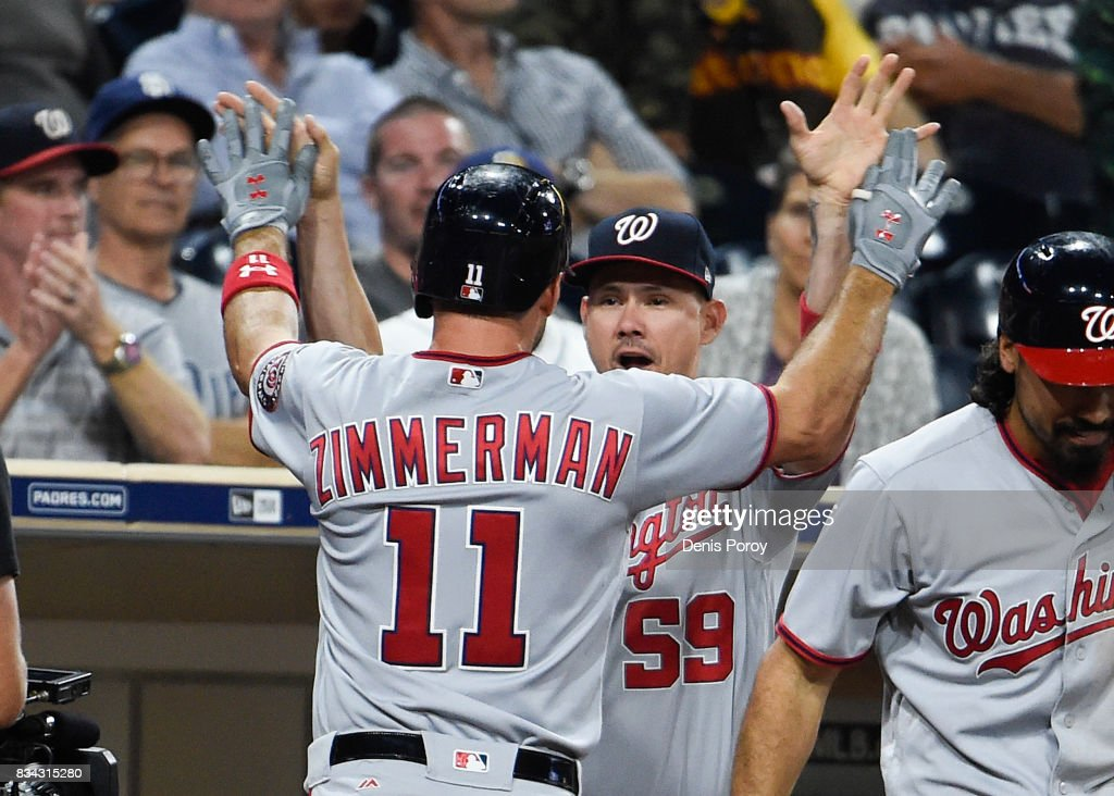 Ryan Zimmerman #11 of the Washington Nationals is congratulated by Jose Lobaton #59 after he hit a solo home run during the eighth inning of a baseball game against the San Diego Padres at PETCO Park on August 17, 2017 in San Diego, California.