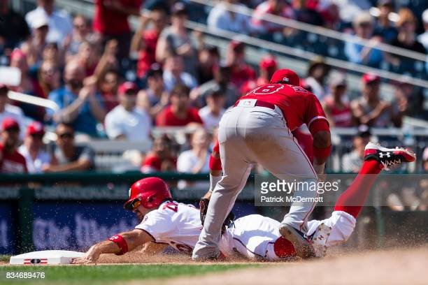 Ryan Zimmerman of the Washington Nationals is tagged out at third base by Luis Valbuena of the Los Angeles Angels of Anaheim in the eighth inning...