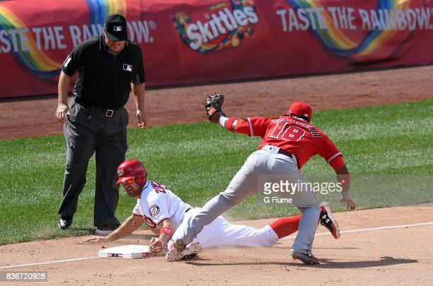 Ryan Zimmerman of the Washington Nationals is tagged out at third base by Luis Valbuena of the Los Angeles Angels at Nationals Park on August 16 2017...