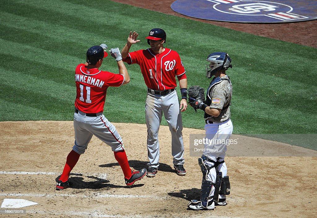 Ryan Zimmerman #11 of the Washington Nationals, left, is congratulated by Stephen Lombardozzi #1 after hitting a two-run homer as Nick Hundley #4 of the San Diego Padres looks on during the fourth inning of a baseball game at Petco Park on May 19, 2013 in San Diego, California.