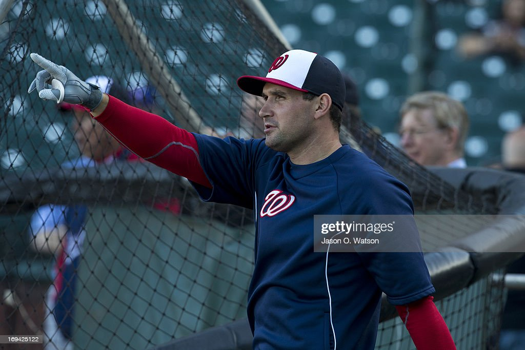 <a gi-track='captionPersonalityLinkClicked' href=/galleries/search?phrase=Ryan+Zimmerman+-+Baseball+Player&family=editorial&specificpeople=534809 ng-click='$event.stopPropagation()'>Ryan Zimmerman</a> #11 of the Washington Nationals points during batting practice before the game against the San Francisco Giants at AT&T Park on May 21, 2013 in San Francisco, California. The San Francisco Giants defeated the Washington Nationals 4-2 in 10 innings.