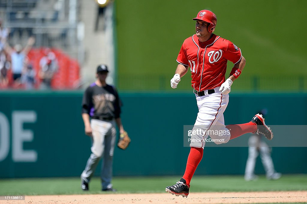 <a gi-track='captionPersonalityLinkClicked' href=/galleries/search?phrase=Ryan+Zimmerman+-+Baseball+Player&family=editorial&specificpeople=534809 ng-click='$event.stopPropagation()'>Ryan Zimmerman</a> #11 of the Washington Nationals runs the bases after hitting a solo home run in the ninth inning during a game against the Colorado Rockies at Nationals Park on June 22, 2013 in Washington, DC.