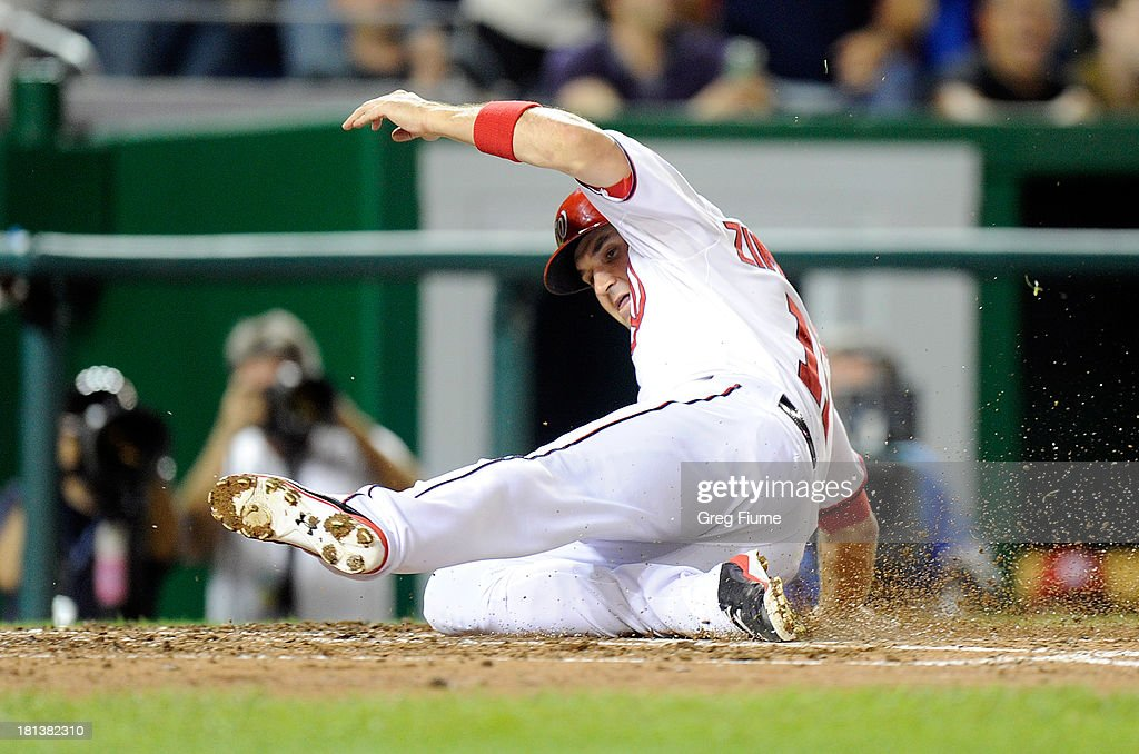 <a gi-track='captionPersonalityLinkClicked' href=/galleries/search?phrase=Ryan+Zimmerman+-+Baseball+Player&family=editorial&specificpeople=534809 ng-click='$event.stopPropagation()'>Ryan Zimmerman</a> #11 of the Washington Nationals scores in the sixth inning against the Miami Marlins at Nationals Park on September 20, 2013 in Washington, DC. Washington won the game 8-0.