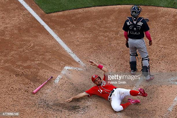 Ryan Zimmerman of the Washington Nationals scores off of a RBI double hit by teammate Wilson Ramos in the eighth inning against the Atlanta Braves at...