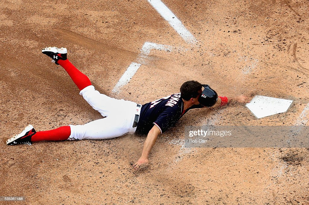 <a gi-track='captionPersonalityLinkClicked' href=/galleries/search?phrase=Ryan+Zimmerman+-+Baseball+Player&family=editorial&specificpeople=534809 ng-click='$event.stopPropagation()'>Ryan Zimmerman</a> #11 of the Washington Nationals slides into home to score a run in the fourth inning against the St. Louis Cardinals at Nationals Park on May 29, 2016 in Washington, DC.