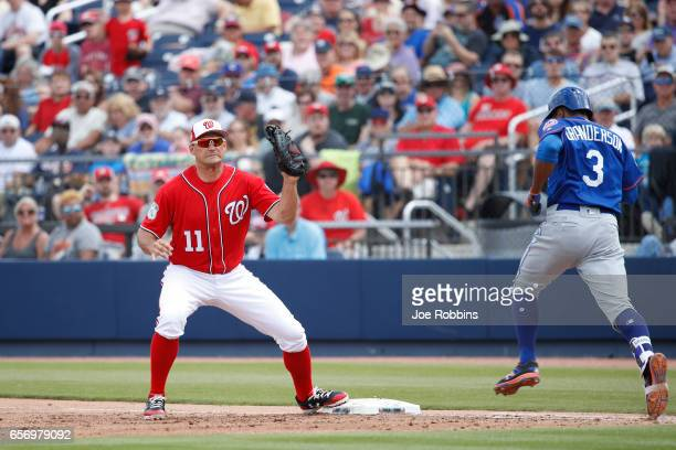 Ryan Zimmerman of the Washington Nationals takes the throw at first base ahead of Curtis Granderson of the New York Mets in the second inning of a...
