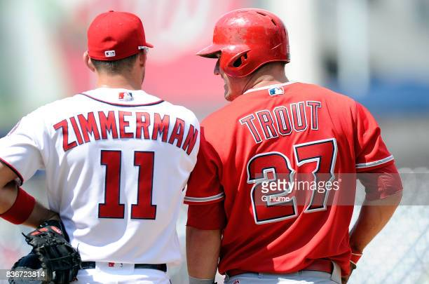 Ryan Zimmerman of the Washington Nationals talks with Mike Trout of the Los Angeles Angels during the game at Nationals Park on August 16 2017 in...
