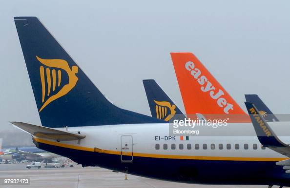 Ryanair and Easyjet airplanes sit at Barajas Airport in Madrid Spain on Friday March 19 2010 Ryanair Holdings Plc Europe's largest discount airline...