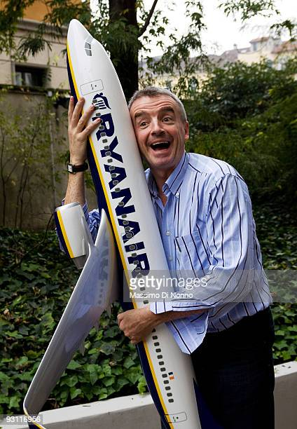 Ryanair CEO Michael O'Leary poses with a model airplane ahead of a press conference on November 17 2009 in Milan Italy O'Leary presented the...