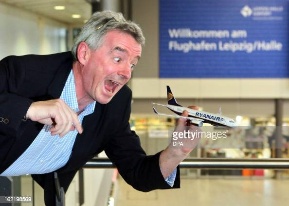 Ryanair CEO Michael O'Leary poses with a model airplane at the Leipzig/Halle airport in Schkeuditz eastern Germany on February 29 following a press...