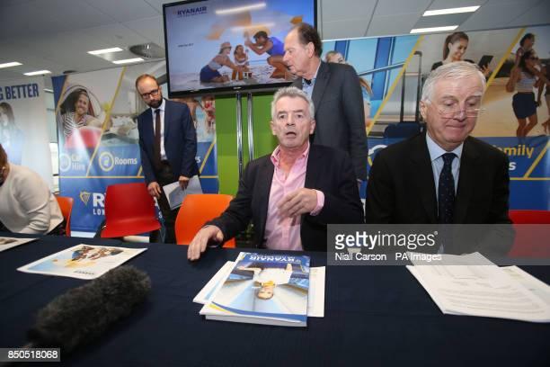 Ryanair Company Secretary Juliusz Komorek CEO Michael O'Leary Directors David Bonderman and Kyran McLaughlin during the company's AGM at the their...