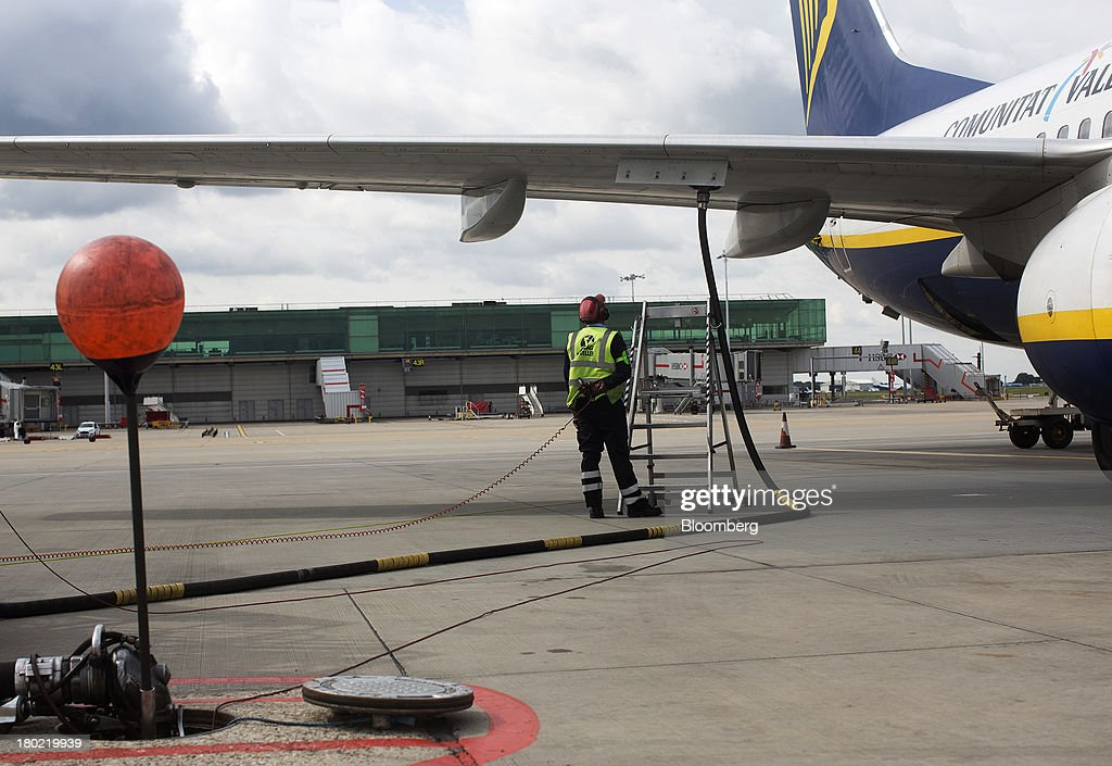 A Ryanair Holdings Plc passenger aircraft is refueled from an underground fuel tank at Stansted Airport, operated by Manchester Airports Group (MAG) in Stansted, U.K., on Tuesday, Sept. 10, 2013. From two planes in 1995, EasyJet has grown to more than 200 Airbus SAS aircraft carrying more than 59 million people annually, 20 million fewer than Ryanair. Photographer: Simon Dawson/Bloomberg via Getty Images