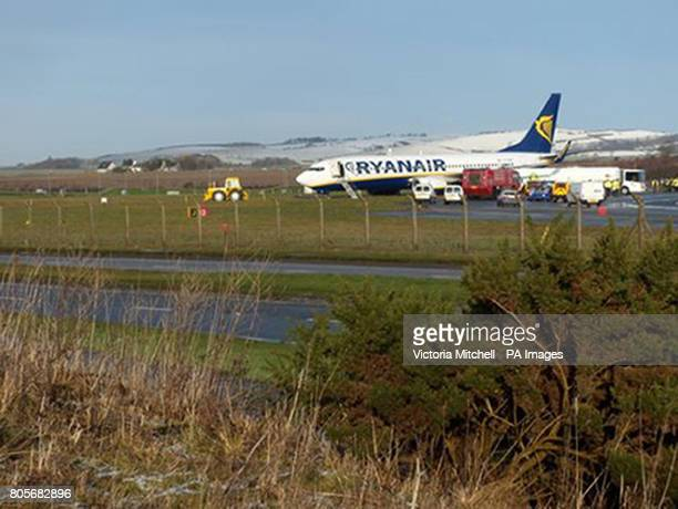 A Ryanair passenger jet carrying 129 people at rest 30 yards from Glasgow Prestwick airport's perimeter fence after skidding off the runway at 9am...