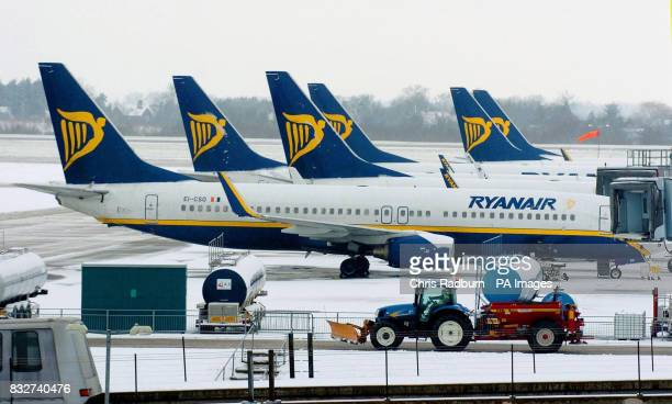 Ryanair planes wait on the snowcovered tarmac at Stansted Airport in Essex