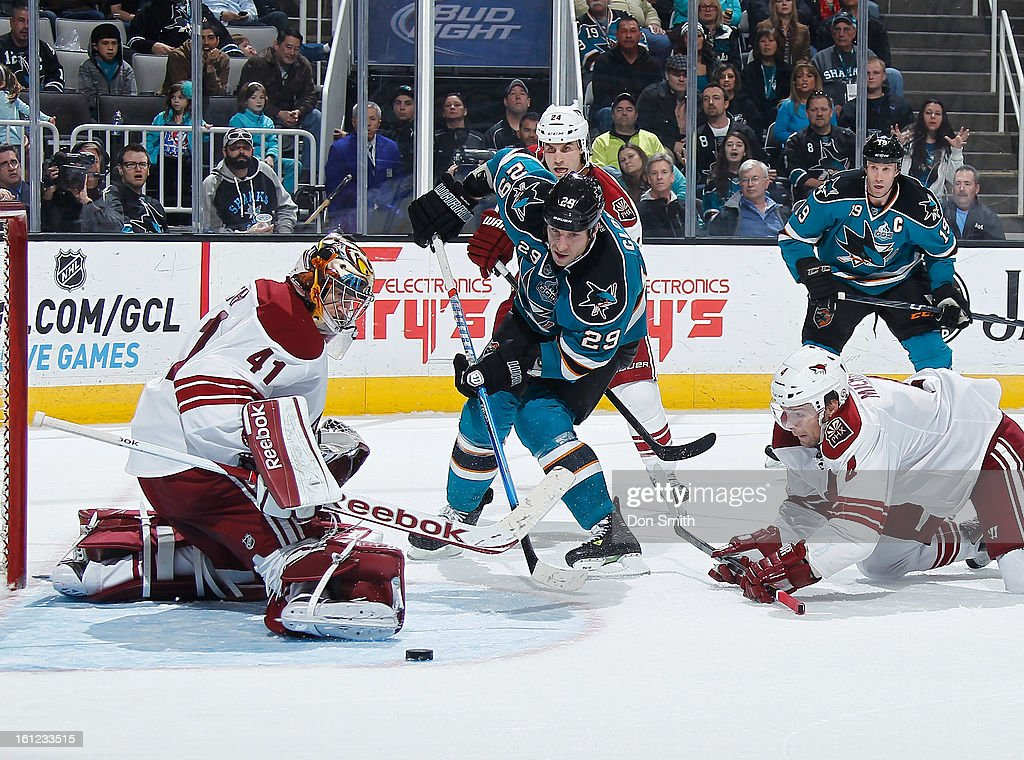 <a gi-track='captionPersonalityLinkClicked' href=/galleries/search?phrase=Ryane+Clowe&family=editorial&specificpeople=736658 ng-click='$event.stopPropagation()'>Ryane Clowe</a> #29 and Joe Thornton #19 of the San Jose Sharks fight for the puck against Mike Smith #41 and <a gi-track='captionPersonalityLinkClicked' href=/galleries/search?phrase=Zbynek+Michalek&family=editorial&specificpeople=243230 ng-click='$event.stopPropagation()'>Zbynek Michalek</a> #4 of the Phoenix Coyotes during an NHL game on February 9, 2013 at HP Pavilion in San Jose, California.