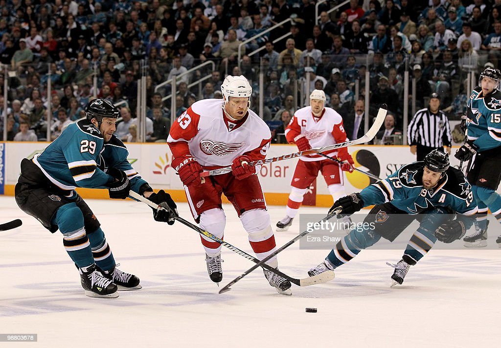 Ryane Clowe #29 and Joe Thornton #19 of the San Jose Sharks try to stop Johan Franzen #93 of the Detroit Red Wings in Game Two of the Western Conference Semifinals during the 2010 NHL Stanley Cup Playoffs at HP Pavilion on May 2, 2010 in San Jose, California.