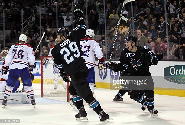 Ryane Clowe and Logan Couture of the San Jose Sharks celebrate after Clowe scored the tying goal in the third period of their game against the...