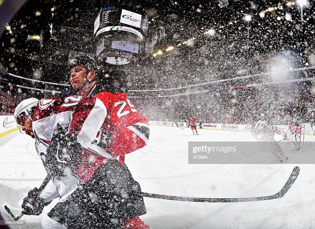 Ryane Clowe of the New Jersey Devils checks Jarome Iginla of the Colorado Avalanche during their game at the Prudential Center on November 15 2014 in...