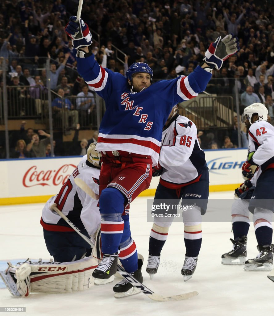 <a gi-track='captionPersonalityLinkClicked' href=/galleries/search?phrase=Ryane+Clowe&family=editorial&specificpeople=736658 ng-click='$event.stopPropagation()'>Ryane Clowe</a> #29 of the New York Rangers celebrates a goal by Carl Hagelin #62 (not shown) at 10:13 of the second period against the Washington Capitals in Game Four of the Eastern Conference Quarterfinals during the 2013 NHL Stanley Cup Playoffs at Madison Square Garden on May 8, 2013 in New York City.