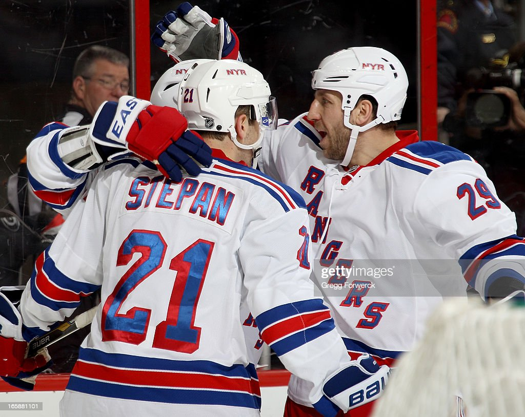 <a gi-track='captionPersonalityLinkClicked' href=/galleries/search?phrase=Ryane+Clowe&family=editorial&specificpeople=736658 ng-click='$event.stopPropagation()'>Ryane Clowe</a> #29 of the New York Rangers joins in the celebration of a second-period goal scored by Derek Stepan #21 against the Carolina Hurricanes during their NHL game at PNC Arena on April 6, 2013 in Raleigh, North Carolina.