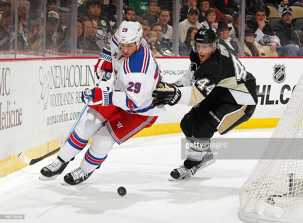 <a gi-track='captionPersonalityLinkClicked' href=/galleries/search?phrase=Ryane+Clowe&family=editorial&specificpeople=736658 ng-click='$event.stopPropagation()'>Ryane Clowe</a> #29 of the New York Rangers moves the puck in front of <a gi-track='captionPersonalityLinkClicked' href=/galleries/search?phrase=Brooks+Orpik&family=editorial&specificpeople=213074 ng-click='$event.stopPropagation()'>Brooks Orpik</a> #44 of the Pittsburgh Penguins on April 5, 2013 at Consol Energy Center in Pittsburgh, Pennsylvania. Pittsburgh won the game 2-1 in a shootout.