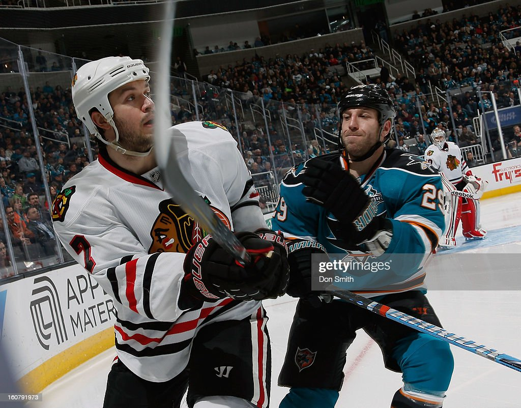 Ryane Clowe #29 of the San Jose Sharks fights for the puck against Brent Seabrook #7 of the Chicago Blackhawks during an NHL game on February 5, 2013 at HP Pavilion in San Jose, California.
