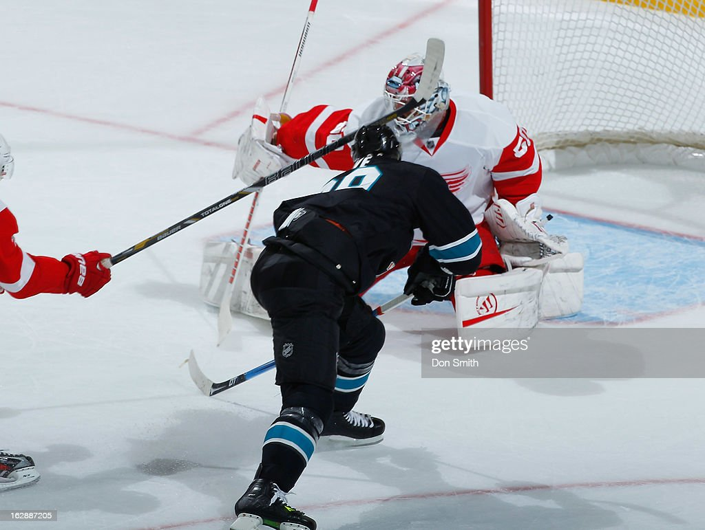 <a gi-track='captionPersonalityLinkClicked' href=/galleries/search?phrase=Ryane+Clowe&family=editorial&specificpeople=736658 ng-click='$event.stopPropagation()'>Ryane Clowe</a> #29 of the San Jose Sharks just misses a goal on a break away against <a gi-track='captionPersonalityLinkClicked' href=/galleries/search?phrase=Jonas+Gustavsson&family=editorial&specificpeople=886789 ng-click='$event.stopPropagation()'>Jonas Gustavsson</a> #50 of the Detroit Red Wings during an NHL game on February 28, 2013 at HP Pavilion in San Jose, California.