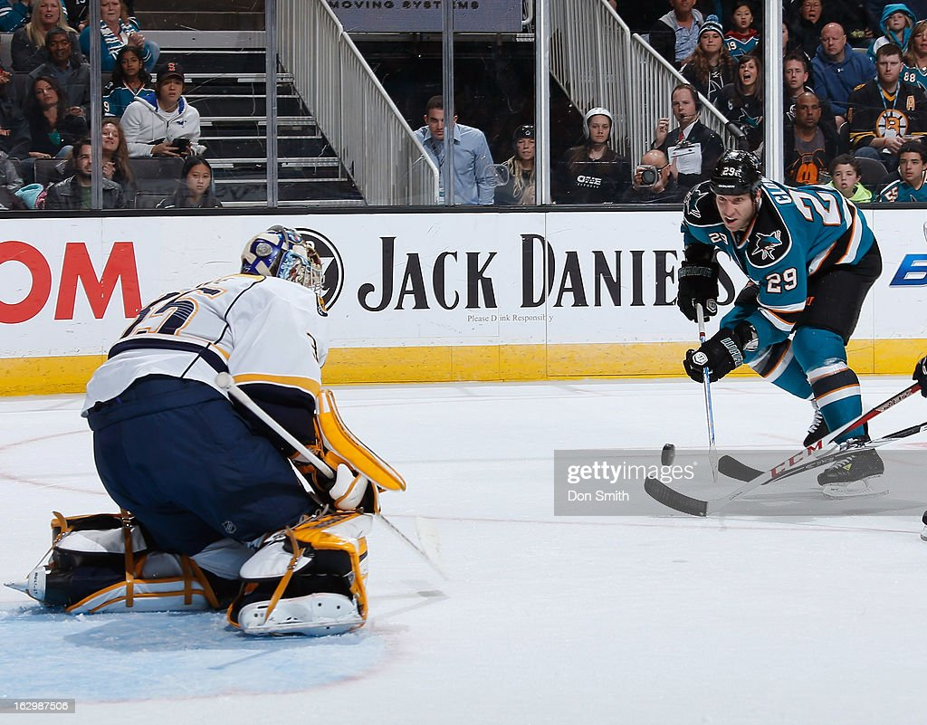 <a gi-track='captionPersonalityLinkClicked' href=/galleries/search?phrase=Ryane+Clowe&family=editorial&specificpeople=736658 ng-click='$event.stopPropagation()'>Ryane Clowe</a> #29 of the San Jose Sharks takes a shot against <a gi-track='captionPersonalityLinkClicked' href=/galleries/search?phrase=Pekka+Rinne&family=editorial&specificpeople=2118342 ng-click='$event.stopPropagation()'>Pekka Rinne</a> #35 of the Nashville Predators during an NHL game on March 2, 2013 at HP Pavilion in San Jose, California.