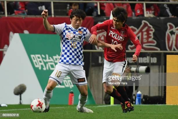 Ryang Yong Gi of Vegalta Sendai controls the ball under pressure of Yosuke Kashiwagi of Urawa Red Diamonds during the JLeague J1 match between Urawa...