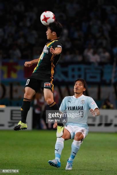 Ryang Yong Gi of Vegalta Sendai heads the ball in front of Tomohiko Miyazaki of Jubilo Iwata during the JLeague J1 match between Vegalta Sendai and...
