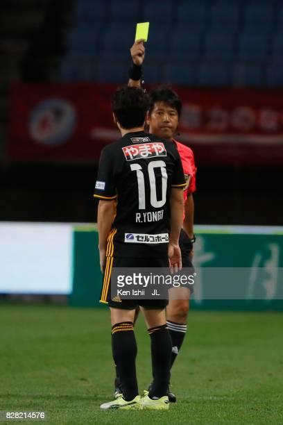 Ryang Yong Gi of Vegalta Sendai is shown a yellow card by referee Kenji Ogiya during the JLeague J1 match between Vegalta Sendai and Jubilo Iwata at...
