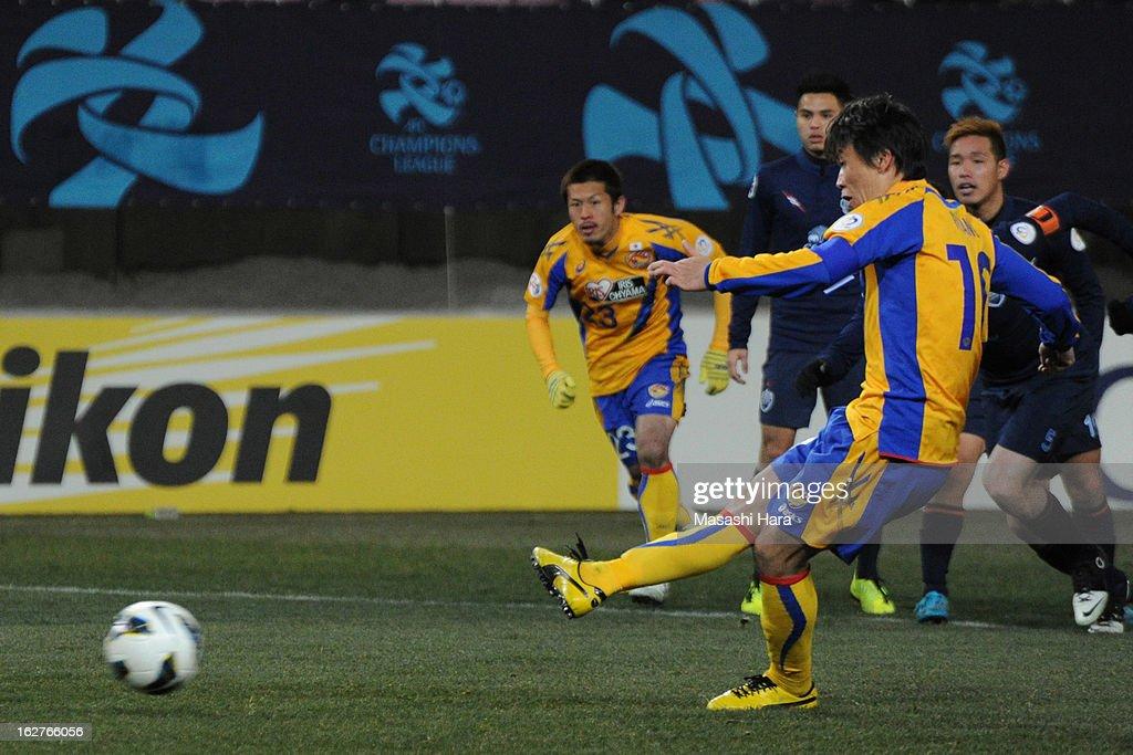 Ryang Yong Gi #10 of Vegalta Sendai scores the first goal during the AFC Champions League Group E match between Vegalta Sendai and Buriram United at Sendai Stadium on February 26, 2013 in Sendai, Japan.