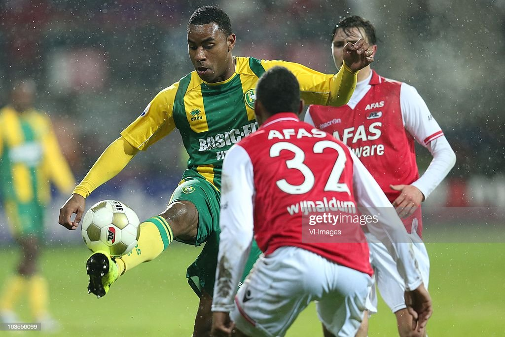 Rydell Poepon of ADO Den Haag,Giliano Wijnaldum of AZ during the Dutch Eredivisie match between AZ Alkmaar and ADO Den Haag at the AFAS Stadium on march 09, 2013 in Alkmaar, The Netherlands