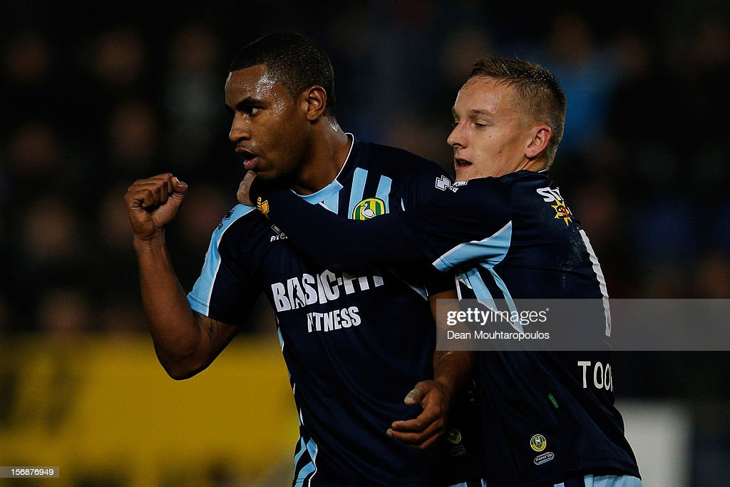 Rydell Poepon (L) of Den Haag celebrates scoring the third goal of the game with team mate Jens Toornstra during the Eredivisie match between NAC Breda and ADO Den Haag at the Rat Verlegh Stadium on November 23, 2012 in Breda, Netherlands.