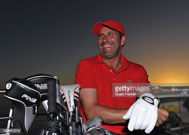 Ryder Cup captain Jose Maria Olazabal of Spain looks on as players hit a shot from a boat to a target on a small boat prior to the start of the...