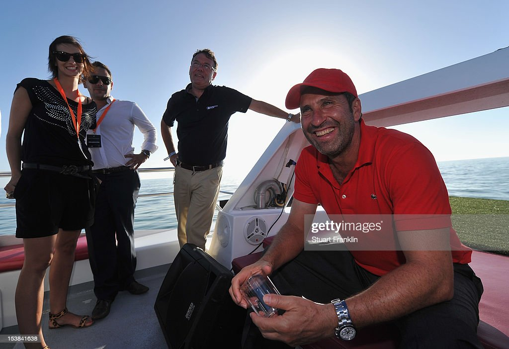 Ryder cup captain Jose Maria Olazabal of Spain relaxes prior to playing a shot from a boat to a target on a small boat prior to the start of the Portugal Masters golf on October 9, 2012 in Faro, Portugal.