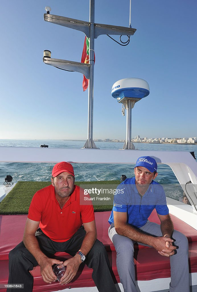 Ryder cup captain Jose Maria Olazabal of Spain relexes with Ricardo Santos of Portugal prior to playing a shot from a boat to a target on a small boat prior to the start of the Portugal Masters golf on October 9, 2012 in Faro, Portugal.
