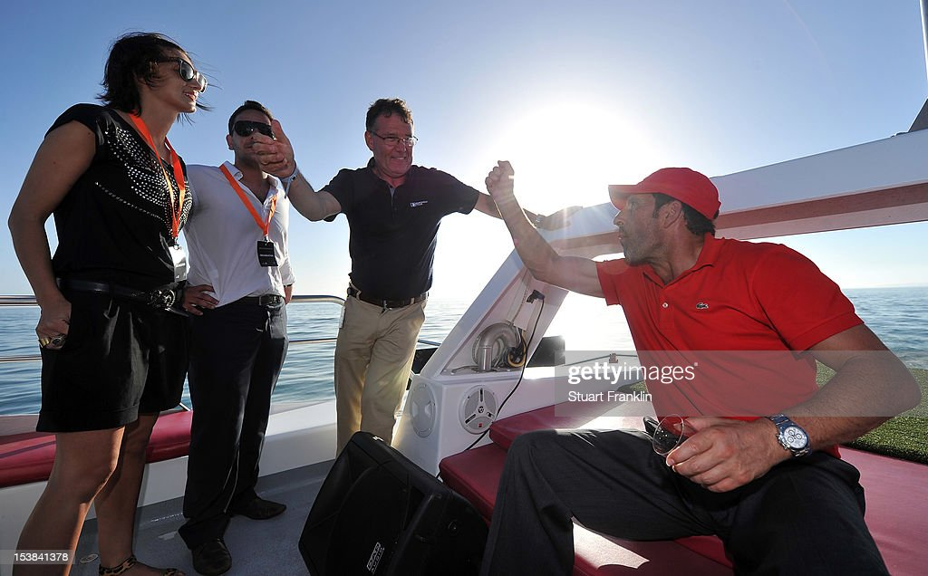 Ryder Cup captain Jose Maria Olazabal of Spain talks with Gordon Simpson of the European tour as players hit a shot from a boat to a target on a small boat prior to the start of the Portugal Masters golf on October 9, 2012 in Faro, Portugal.