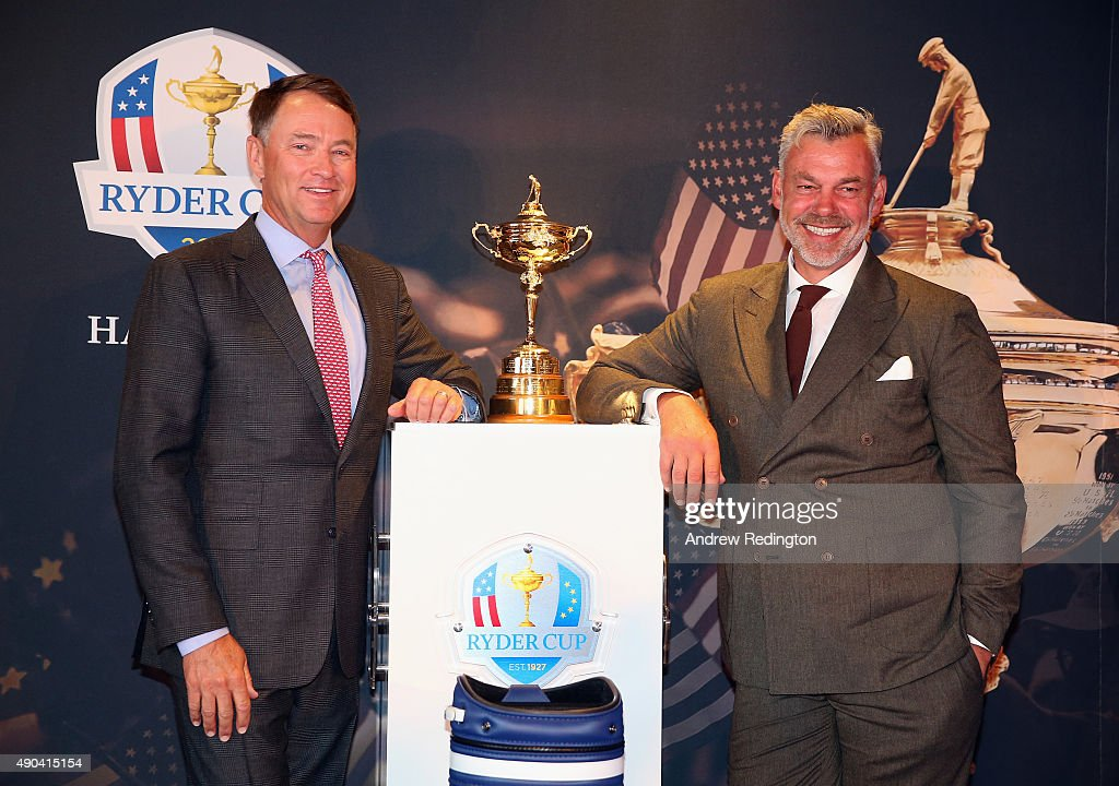 Ryder Cup Captains Davis Love III (left) and Darren Clarke pose with the Ryder Cup trophy and a signed golf bag during the 2016 Ryder Cup 'Welcome To Minnesota' Breakfast at the Windows on Minnesota building on September 28, 2015 in Minneapolis, Minnesota.