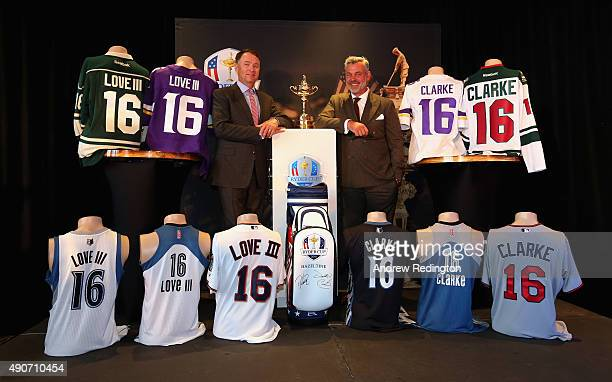 Ryder Cup Captains Davis Love III and Darren Clarke pose with the Ryder Cup trophy and shirts of Minnesota's five professional sports teams during...