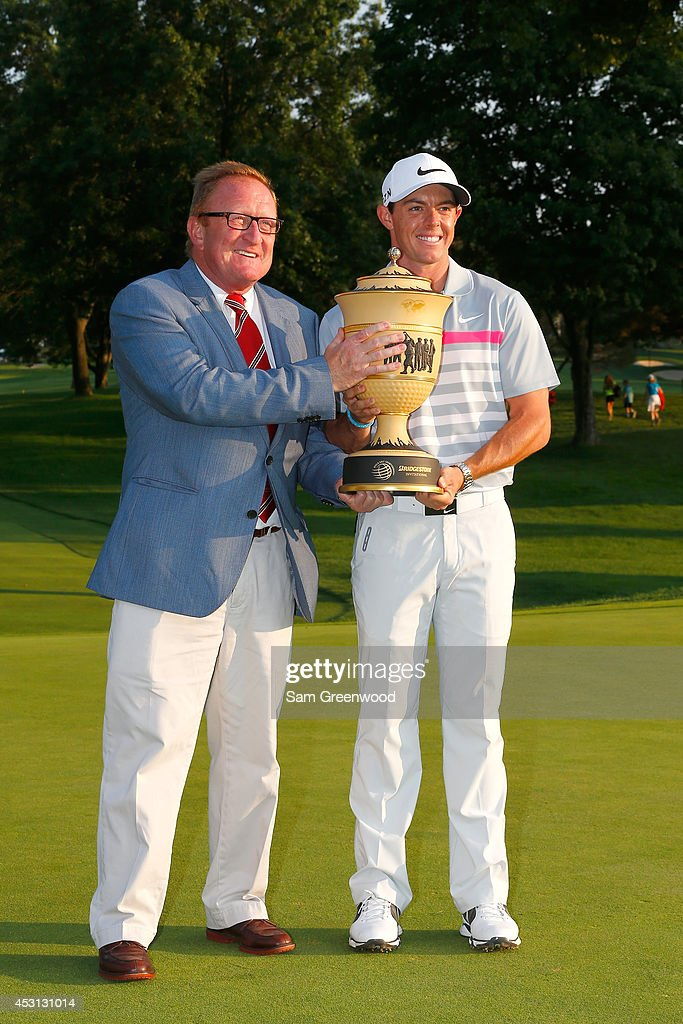Ryder Cup Director Richard Hills poses with Rory McIlroy of Northern Ireland after winning the World Golf Championships-Bridgestone Invitational during the final round at Firestone Country Club South Course on August 3, 2014 in Akron, Ohio.