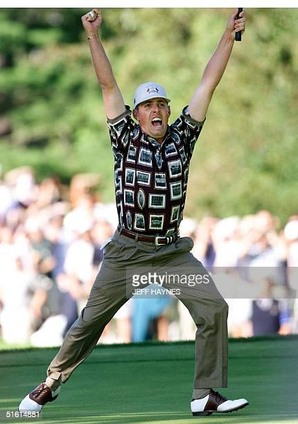 Ryder Cup team member Justin Leonard celebrates his putt against Jose Maria Olazabal of Spain on the 17th hole that clinched the victory for the US...