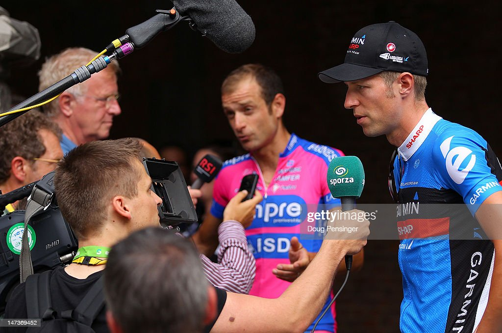 <a gi-track='captionPersonalityLinkClicked' href=/galleries/search?phrase=Ryder+Hesjedal&family=editorial&specificpeople=959739 ng-click='$event.stopPropagation()'>Ryder Hesjedal</a> (R) of Canada riding for Team Garmin-Sharp and Michele Scarponi (C) of Italy riding for Lampre-ISD talk to he media after team presentation prior to the 2012 Tour de France on June 28, 2012 in Liege, Belgium.