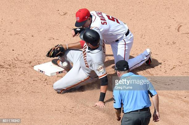 Ryder Jones of the San Francisco Giants steals second base in the eighth inning ahead of the tag of Adrian Sanchez of the Washington Nationals during...